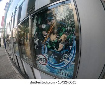 Shinjuku, Tokyo, Japan - October 27 2020:  The Kimetsu No Yaiba movie, Demon Slayer The Movie: Mugen Train is a huge box office hit in Japan. Poster for movie at Shinjuku Wald 9 theatres.
