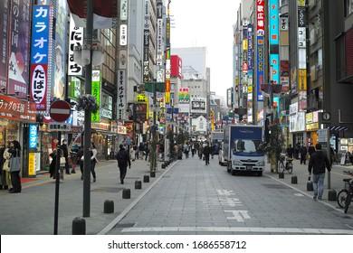 SHINJUKU, TOKYO/JAPAN - MARCH 13, 2020: Commercial buildings, billboards and neon signs in Kabukicho night life district in Shinjuku ward, downtown Tokyo.