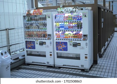 SHINJUKU, TOKYO/JAPAN - MARCH 18, 2020: Soft drink vending machines are installed outside the commercial building of Mode Gakuen Cocoon Tower in NIshi Shinjuku.