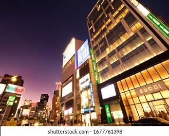 Shinjuku Ward, Tokyo / Japan-March 5, 2020: Shinjuku Station East Exit Building at Sunset. Shinjuku is one of the busiest downtown areas in Japan.