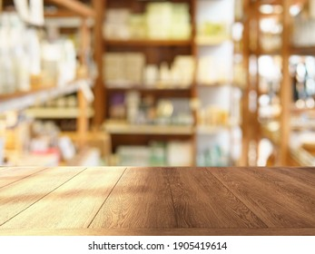 Shinny empty natural wooden counter top in an eco-friendly grocery store with beautiful wooden products shelf in background. Nobody, Healthy products display, Day light, Blurred, Selective focus.