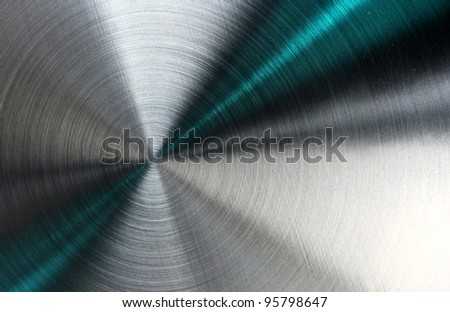 Shiny abstract metallic texture with blue rays pattern.