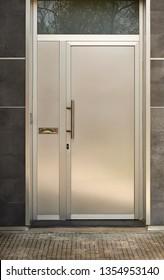 shiny aluminum door in a dark wall