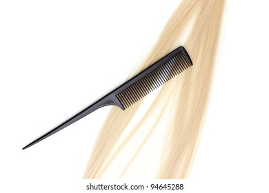Shiny blond hair and comb isolated on white