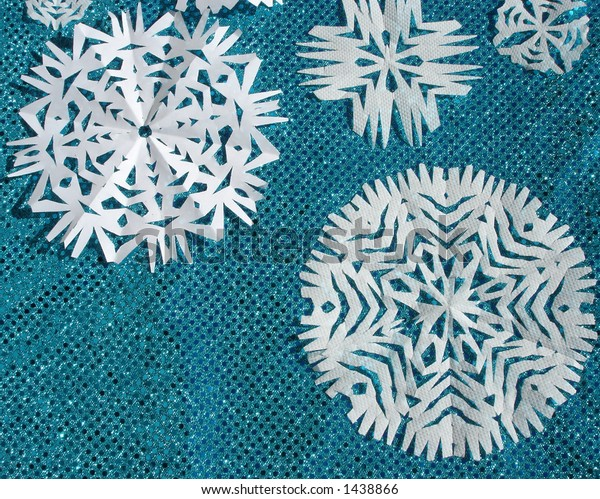 Shiny Blue Cloth and Handmade Paper Snow Flakes