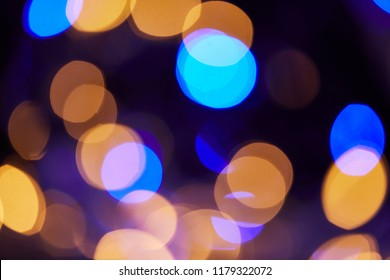 shiny blue and golden bokeh christmas background