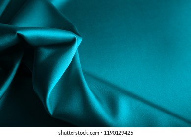 Shiny blue satin curved in various lines