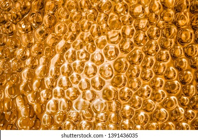 Shiny brass or bronze metal textured background with highlights and circles