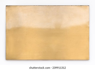 Shiny brass yellow metal sign plate texture isolated on white background