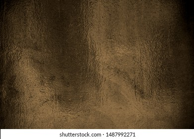 Shiny brown foil background texture with light effect