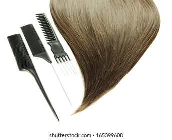 Shiny brown hair with combs isolated on white