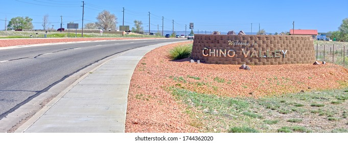 A shiny chrome welcome sign for the town of Chino Valley Arizona.