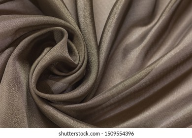 Shiny cloth background with beige vail textile
