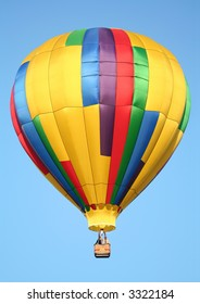 A Shiny Colorful Hot Air Balloon in a Clear Blue Sky