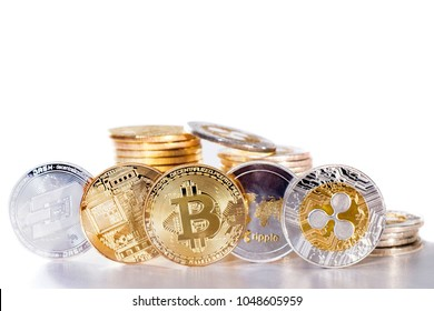 Shiny crypto currency coins on a white background.