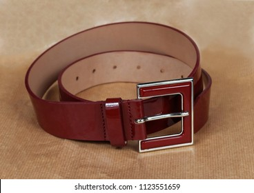 Shiny dark red patent leather belt accessory