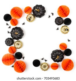 Shiny Decorative Pumpkins and Honeycomb balls. Halloween decorations. Flat lay, top view trendy holiday concept.