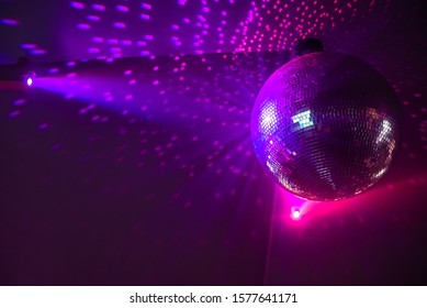 Shiny disco ball with lightning effects on stage