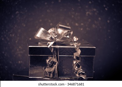 A shiny gift box in darker tones, giving the retro feeling