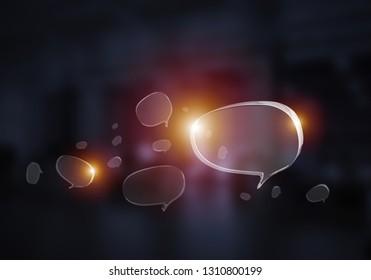 Shiny glass speech bubble on dark background. Mixed media