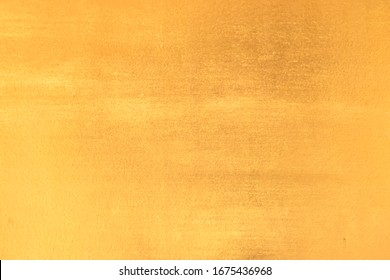 The shiny gold background For design and decoration