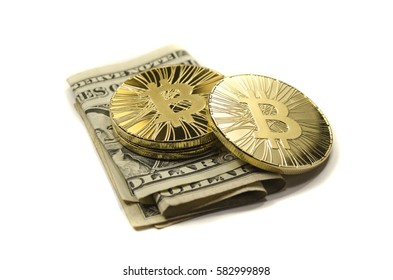 Shiny gold Bitcoin coins and US dollars on white background