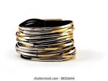 Shiny gold color leather bracelet isolated on white