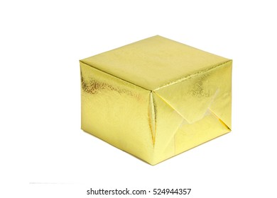 A shiny gold gift box on white background, season greeting concept.