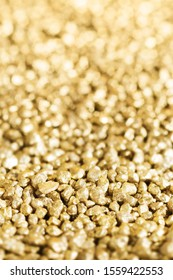 Shiny gold nuggets detail with blurred background