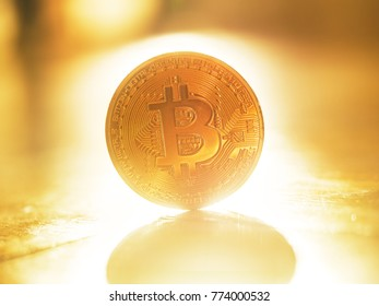 Shiny golden bitcoin BTC coin, macro closeup. Blockchain investment concept.