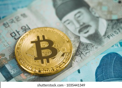 Shiny golden bitcoin on Korea Won banknote background, Cyrptocurrency concept