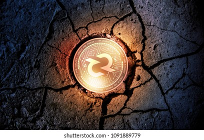 shiny golden DECRED cryptocurrency coin on dry earth dessert background mining