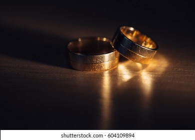 Shiny golden rings lie in the shadow