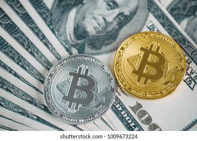 Shiny golden and silver bitcoin on top of dollar banknote background, crypto currency concept, future money and finance
