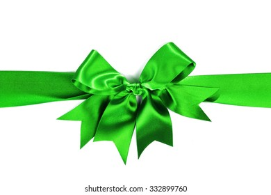 Shiny green satin ribbon with bow on white background
