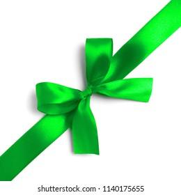 Shiny green satin ribbon on white background. studio shot