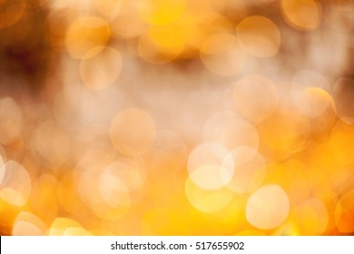 Shiny Lights On Warm Golden Background.