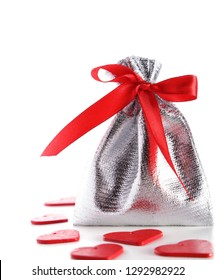 Shiny little bag with red bow