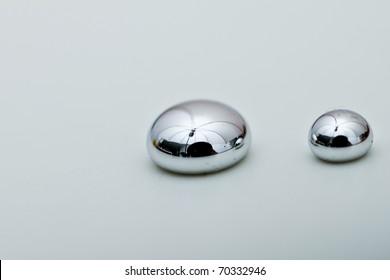 Shiny Mercury drops on a white background
