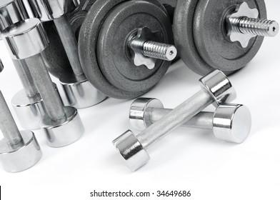 Shiny metal dumbbells. Exercise equipment.