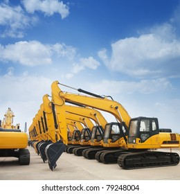 shiny and modern yellow excavator machines