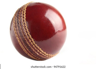A shiny, new test match cricket ball, isolated on a white background.