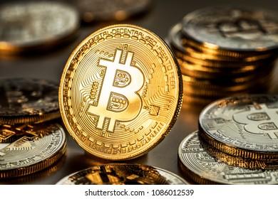 Shiny physical bitcoins. Blockchain technology. - Shutterstock ID 1086012539