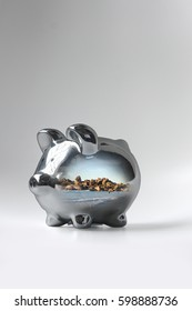 A shiny piggy bank and a holiday scene.