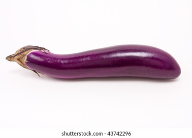 "Shiny purple ""pink aubergine"" against white background from low viewpoint."