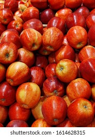 shiny red apples at an indoor market