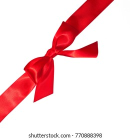 Shiny red bow and ribbon isolated on white background.
