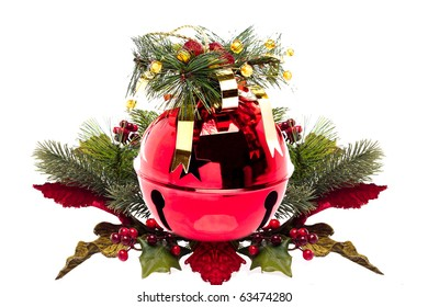 Shiny red jingle bell with a holly spring, ribbon on an isolated on white with copy space