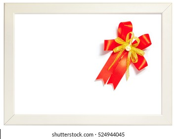 Shiny red ribbon bow decorated on white photo frame, season greeting concept. (left space for text)