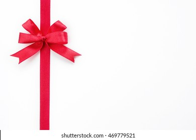 Shiny red ribbon bow isolated on white background, copyspace